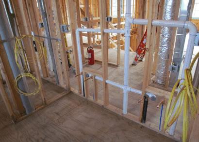 plumbing being run through internal walls